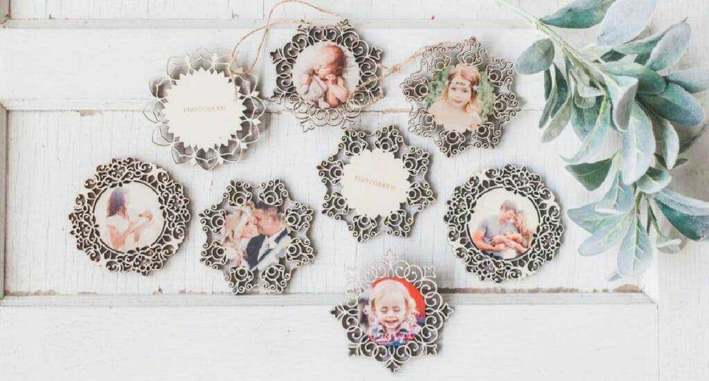 A flat lay of PhotoBarn Ornate Wooden Ornaments