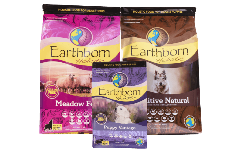 Bags of Earthborn Holistic Meadow Feast, Primitive Natural, and Puppy Vantage dog food