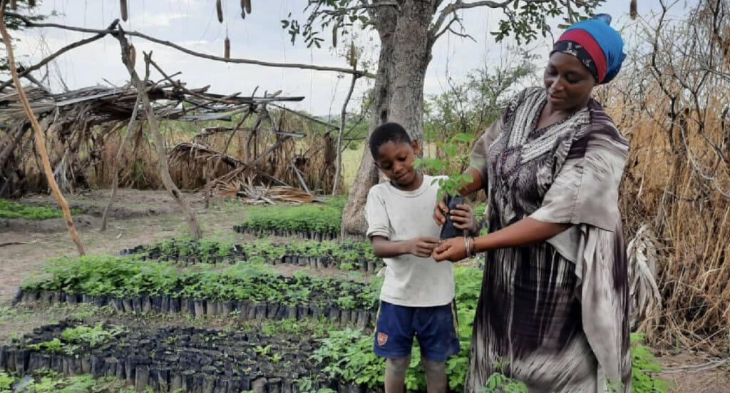 Forest garden farmer, Salma, and her son