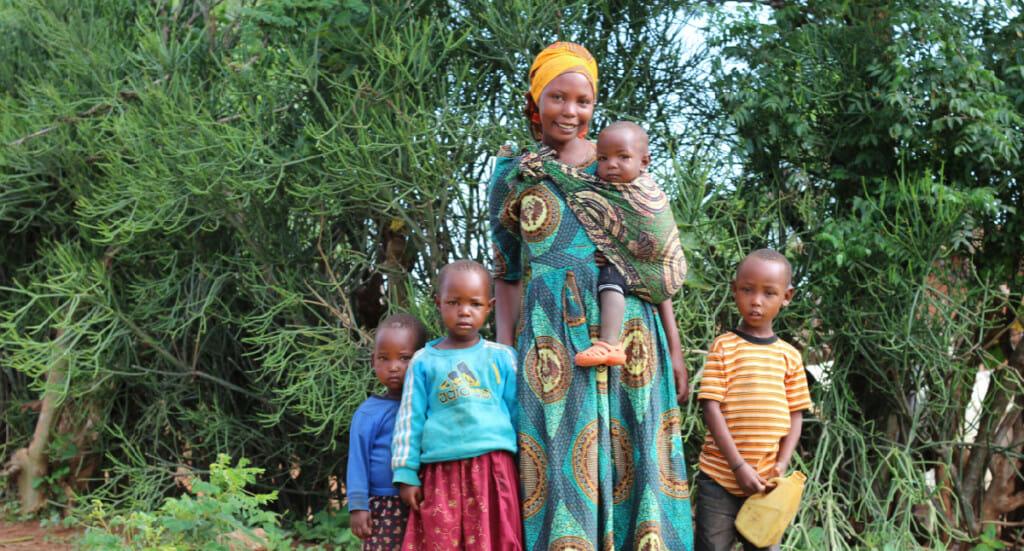 A forest garden farmer with her children