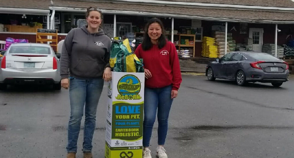 Henniker employees with their ReBorn recycling bin