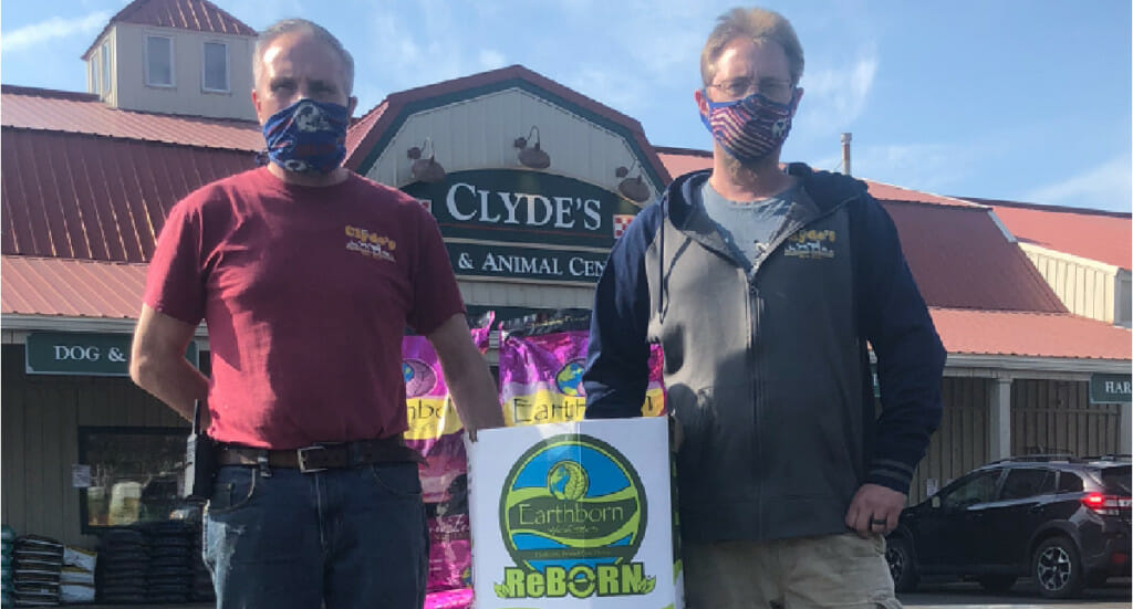 Clyde's Feed employees with their ReBorn recycling bin