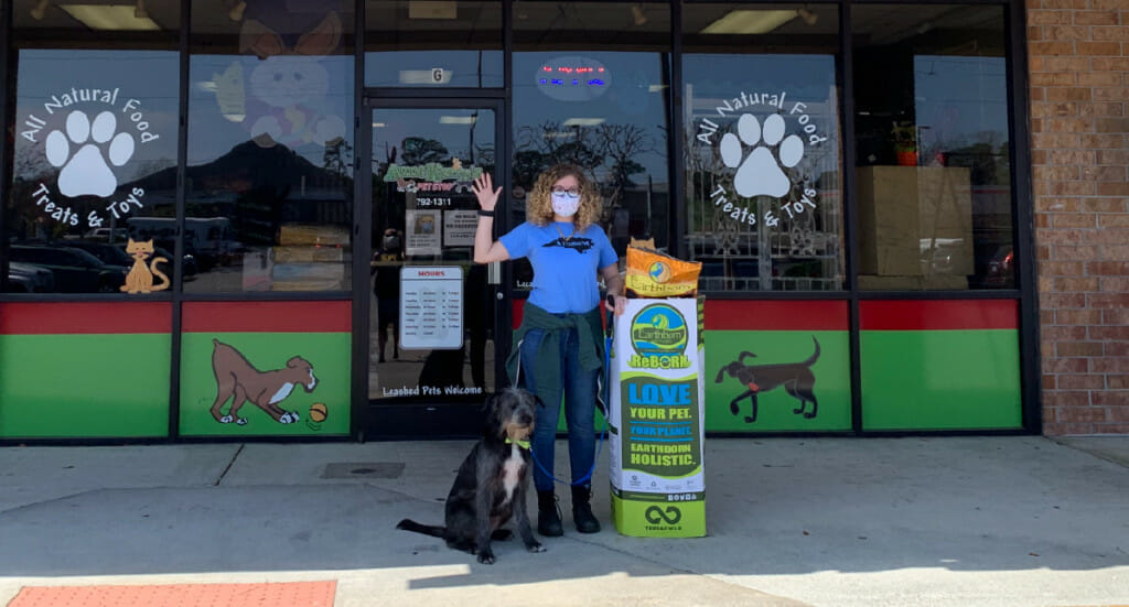 Aunt Kerry's Pet Stop employees with their ReBorn recycling bin
