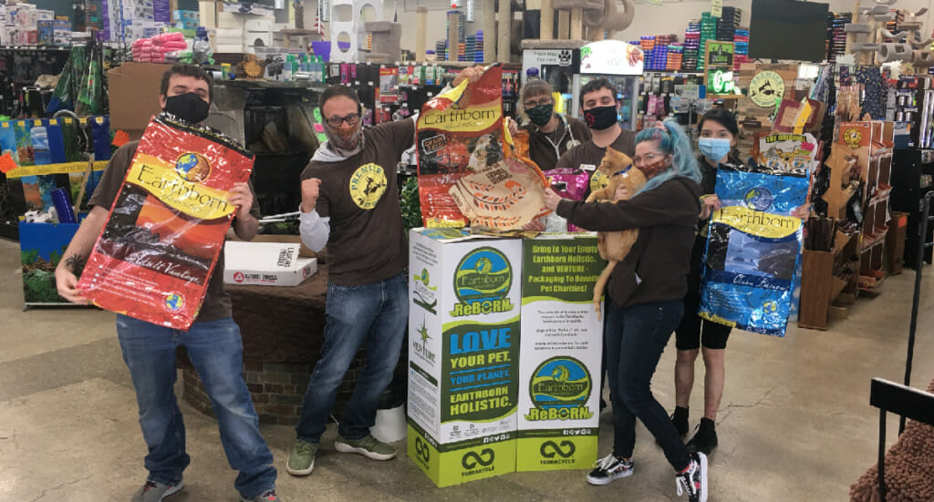 Premier Pet Supply employees with their ReBorn recycling bin
