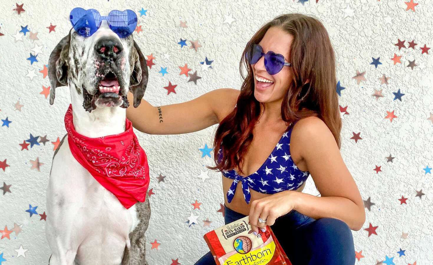 A woman and her dog wear 4th of July-themed sunglasses and bandanas